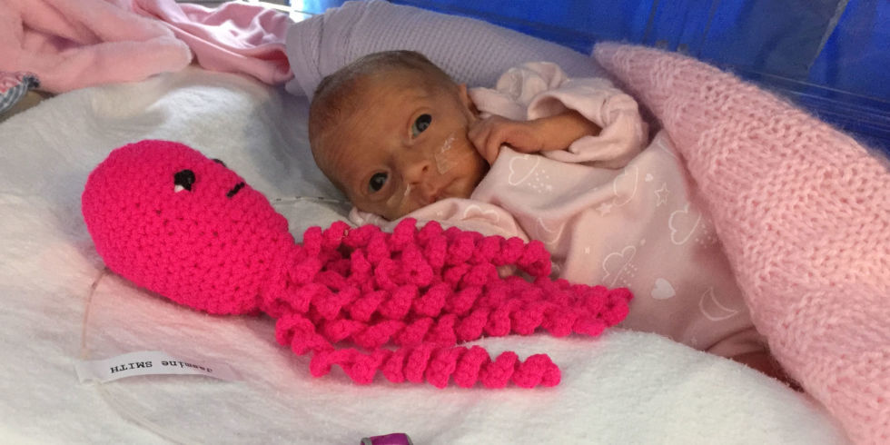 baby with crocheted octopus at Pool hospital. Copyright: Pool Hospital