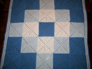 Solid granny square crochet blanket with diamond motif. Free pattern.