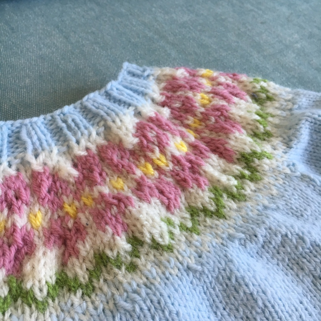 The yoke of a baby sweater