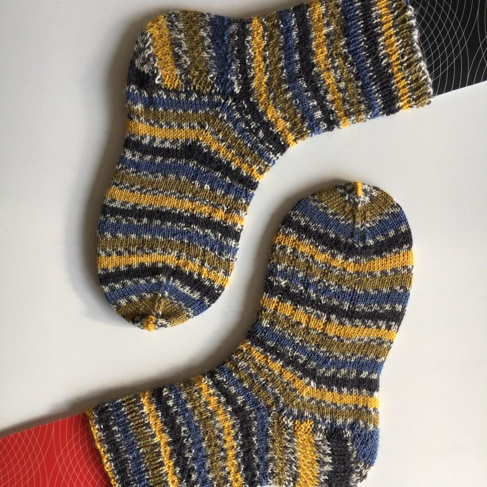 handknit socks on homemade sock blockers