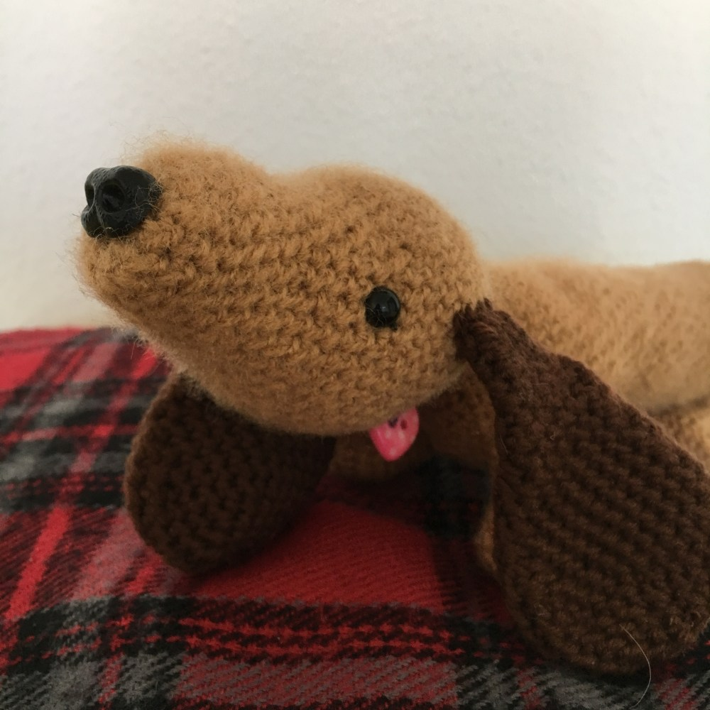 Close up of cute amigurumi dashund dog