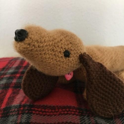 Close up of cute amigurumi dashund dog