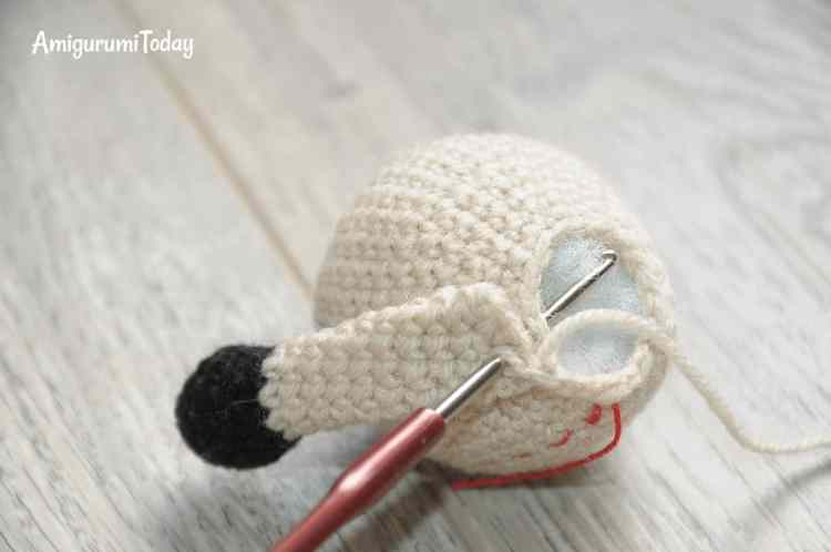 Amigurumi Tommy the Dog crochet pattern - attaching arms