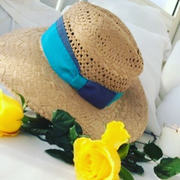 Beautiful hat made with natural straw and turquoise ribbon one size