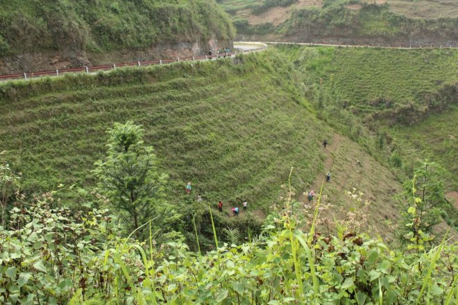 Farmers on steep slopes, Ha Giang bus how to book