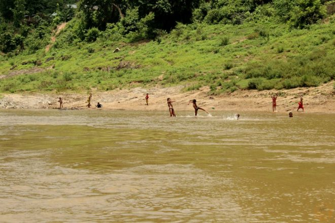 Children from small villages playing in the river