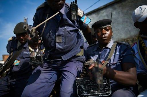 Des policiers congolais assis à l'arrière d'un pick-up à Goma, dans l'est de la RDCongo, le 2 décembre 2012.   AFP/Archives   PHIL MOORE