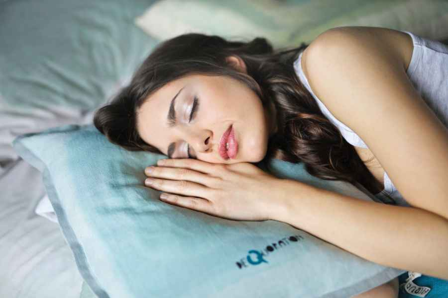 woman sleeping on blue pillow
