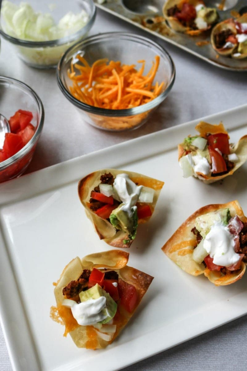 Mini Wonton Taco Cups: All the fun of a taco in a mini baked wonton cup. The perfect appetizer.
