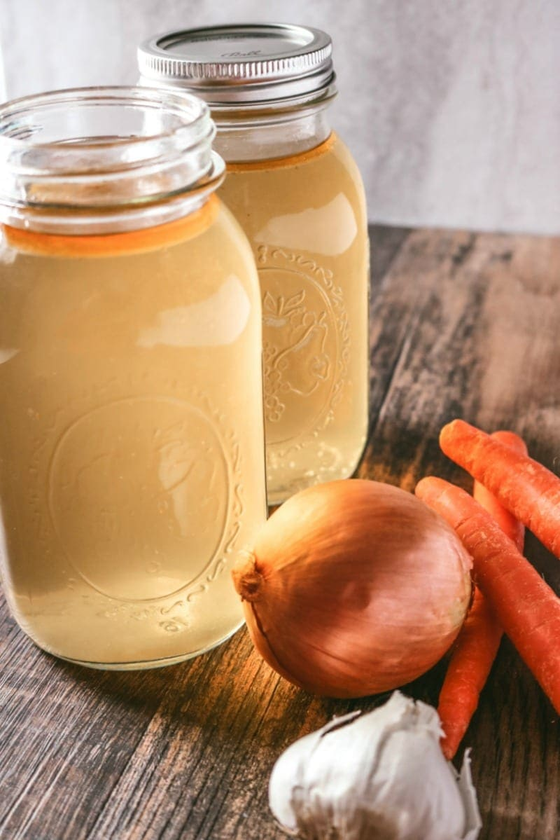 Homemade Chicken Stock for Pennies: Step by step instructions on how to make homemade chicken stock on the stove, Slow Cooker, or Instant Pot.