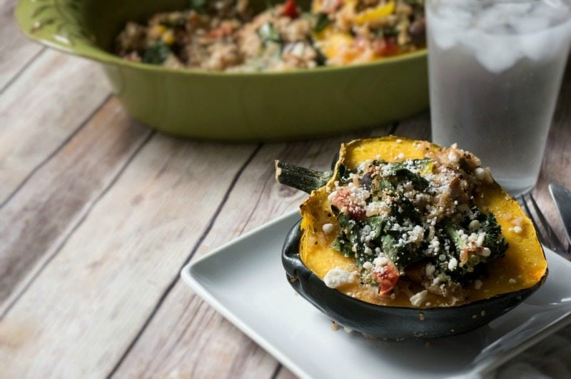 Hearty quinoa that has been studded with the flavors of Mediterranean Cuisine, is stuffed inside tenderly baked acorn squash for a filling gluten free meal that is packed with nurtrition.
