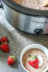 Mix all the ingredients together in a slow cooker and set it before bed and wake up to a hearty, gluten-free breakfast! This strawberry and cream oatmeal is a creamy delicious way to start any day!