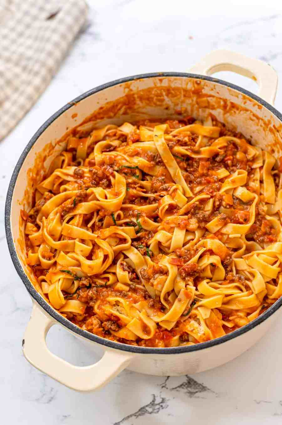 Dutch Oven pan with pasta bolognese.