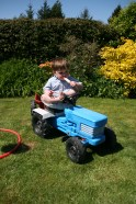 Happiness is a lolly and a tractor.