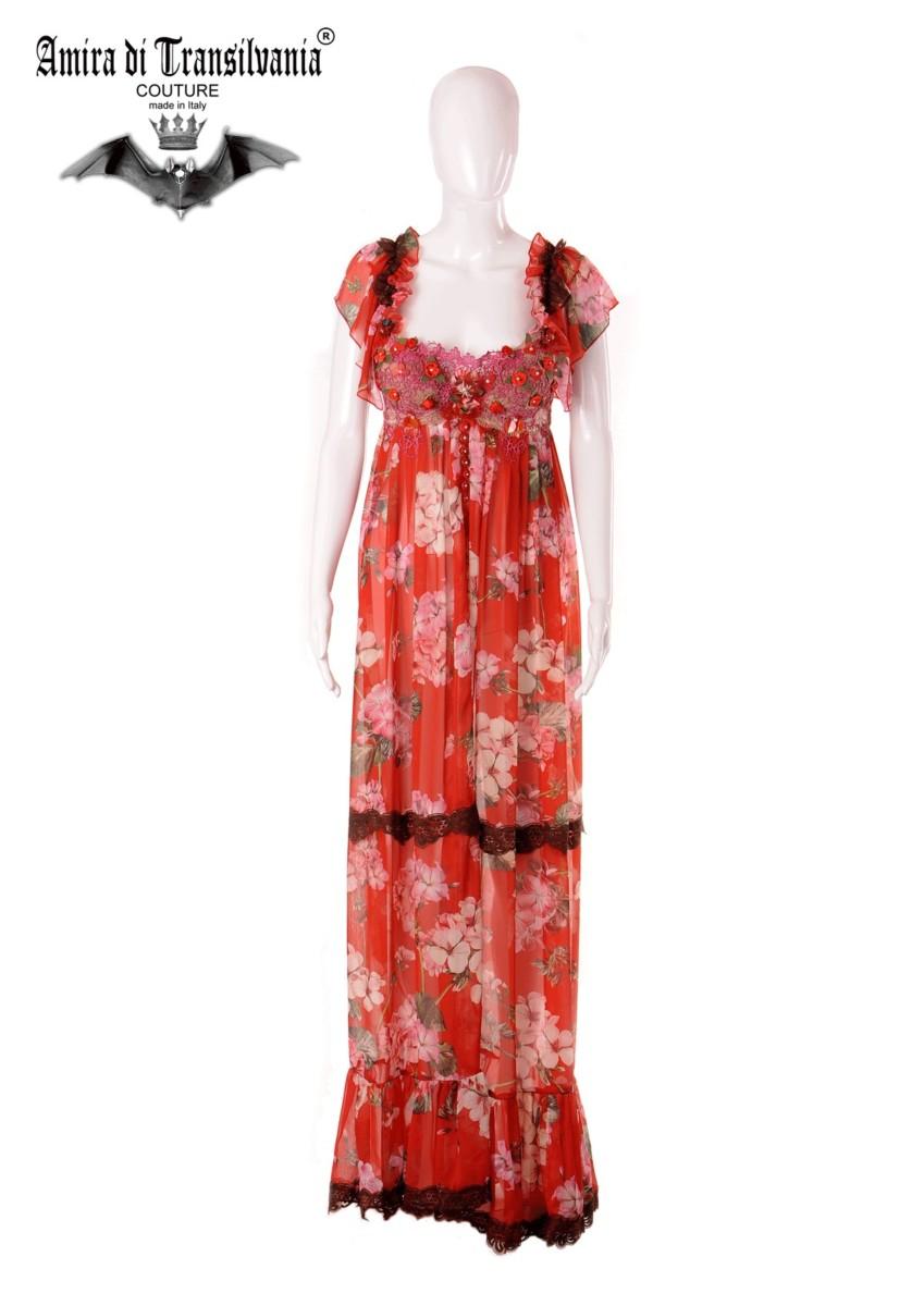 Abito couture rosso con fiori d'arancio
