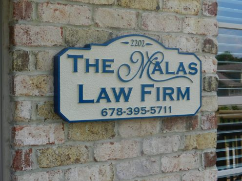 The Malas Law Firm Sand Blasted Sign