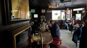 Modern day patrons of the White Horse Tavern, where past and present meet
