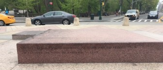 Benches surrounding the memorial with quotes from Douglass