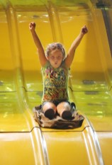 Marykate Merriman, 9, from Gadsden, Alabama, rides a giant slide. Merriman attended the fair with her grandmother, Natalie Johnson of Boyle County.