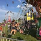 Alaina Campbell, 2, waves to the camera while on a swing ride Wednesday night at the Boyle County Fair.