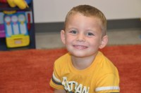 Harper Hughes, 4, at his fourth learning session with Megan Elsea.