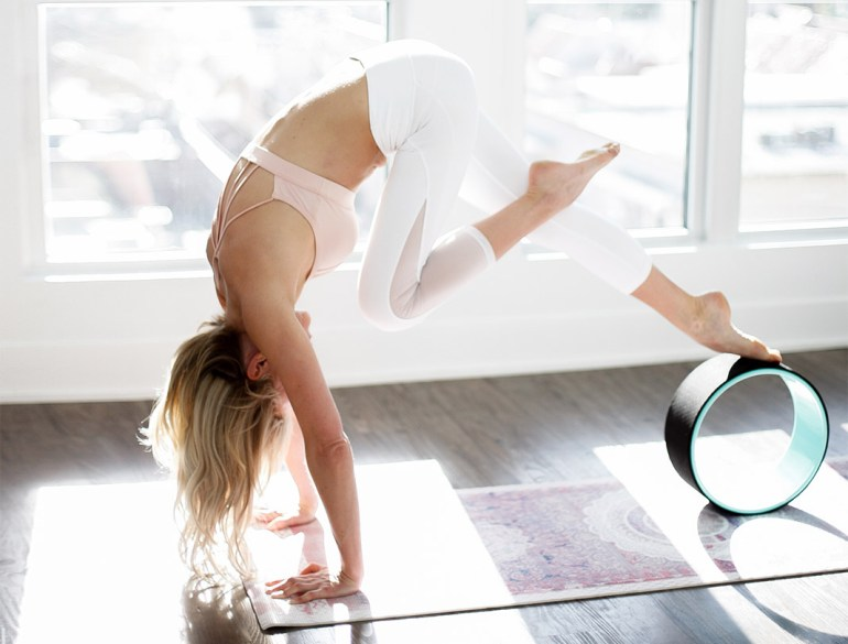 Claire Grieve for Amodrn trialling the Dharma Yoga Wheel