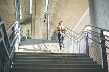 woman running stairs fitness motivation