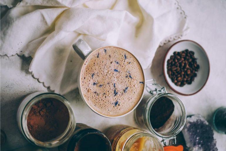 Flat lay of powdered medicinal mushrooms and a mushroom latte