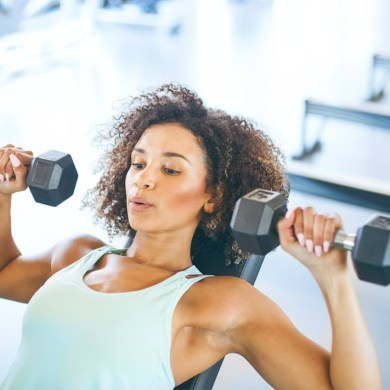 woman lifting weights weight loss