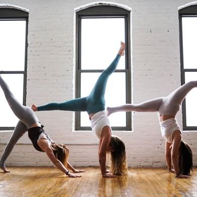 three women doing yoga wellness