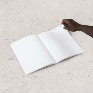 A man's hand turning over a blank page of a book