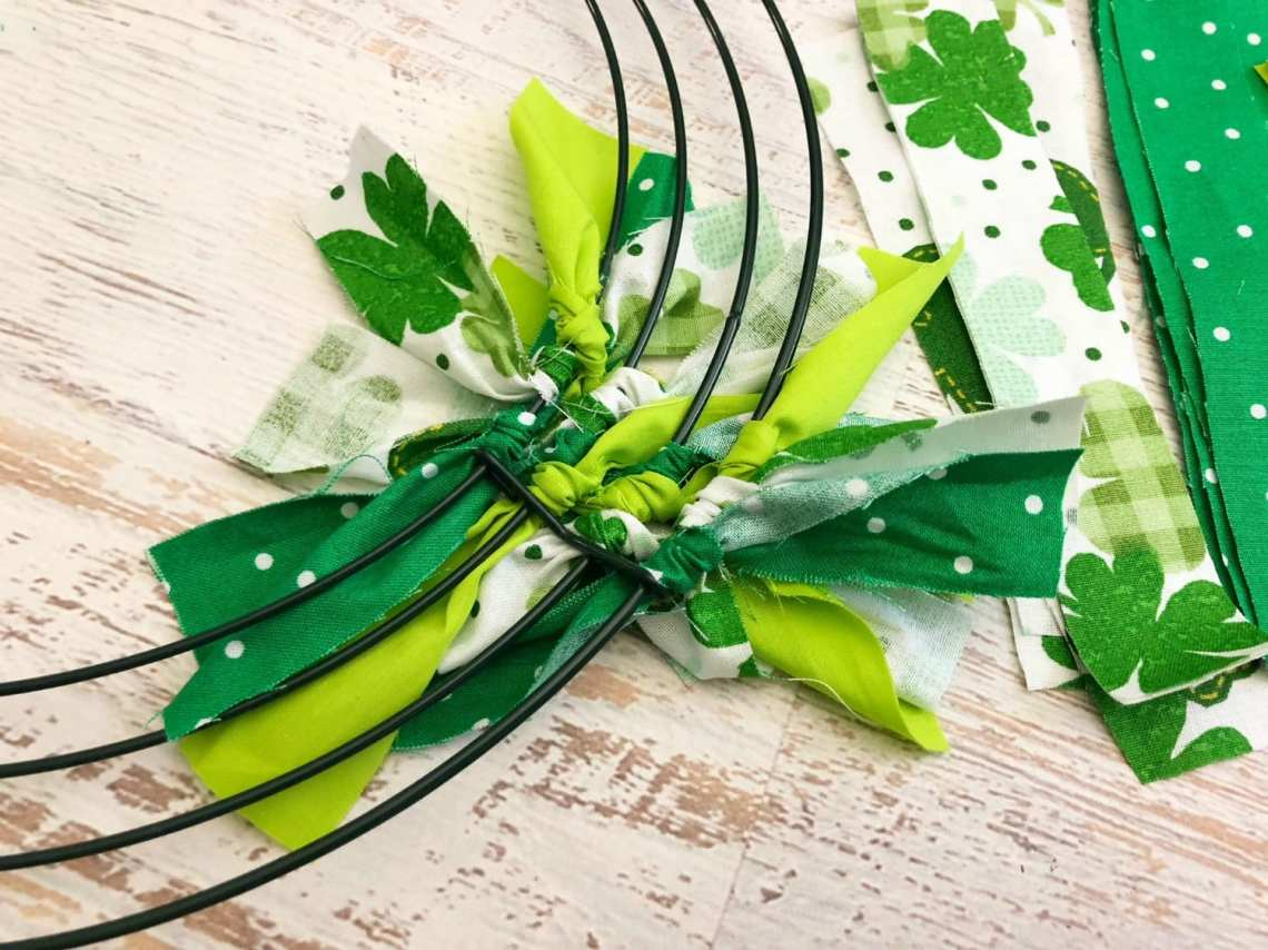 Green Fabric tied onto the frame will make your wreath perfect for St. Patrick's day!