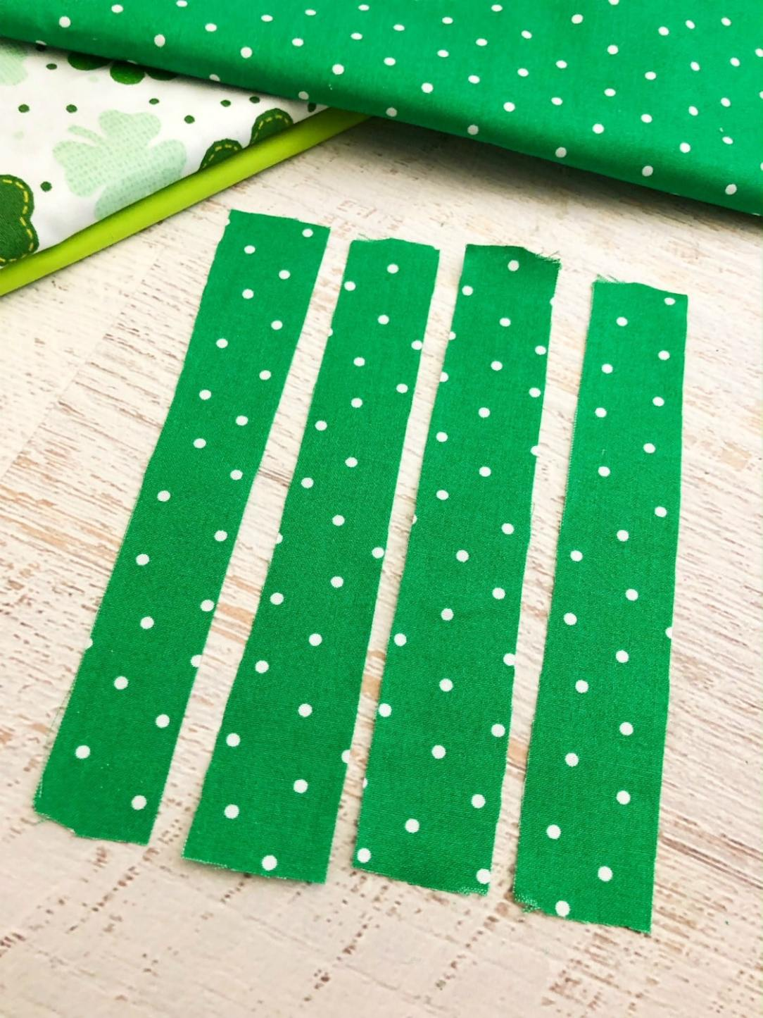 St. Patrick's Day fabric cut into strips
