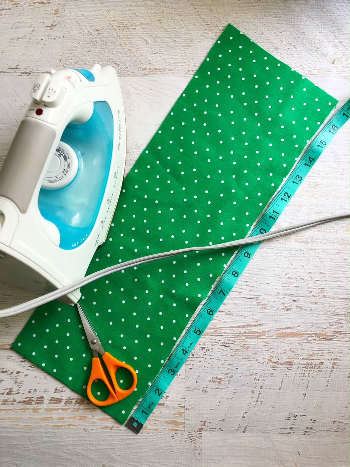 Green Fabric being ironed to hang the shamrock wreath with.