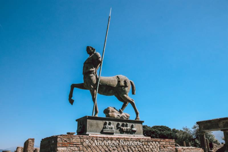 statue of a centaur holding a spear in Pompeii