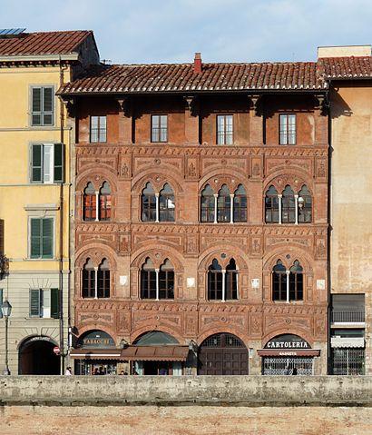 Redbrick exterior of the Palazzo Agostini in Pisa