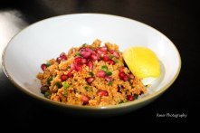 Cous cous with pimenton dulce, green chili & pomegranit