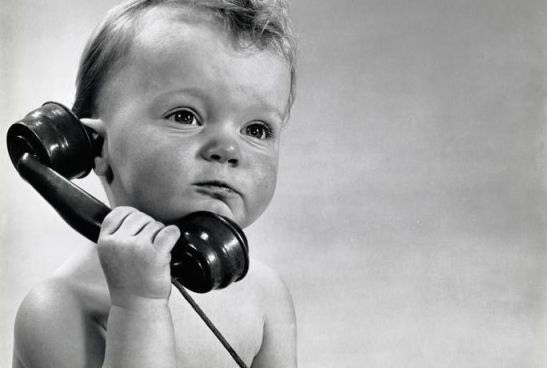 Vintage photo of baby boy talking on phone