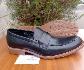 Black penny loafer
