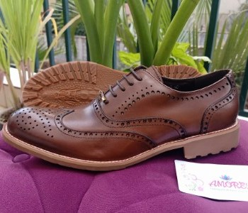 Dark brown brogue with brown sole