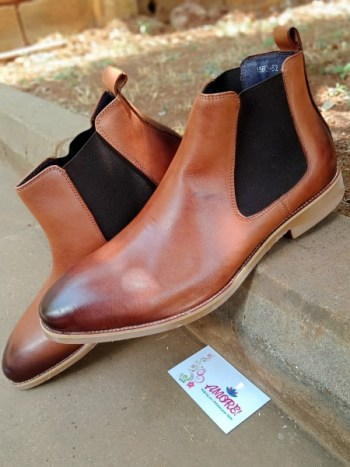 Brown chelsea boot with brown sole