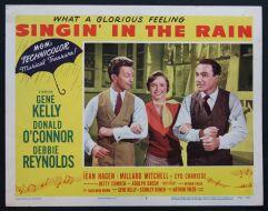 """Cartel """" Cantando bajo la lluvia """" - Metro Goldwym Mayer - sin duda unas de las bandas sonoras muy populares de la época"""