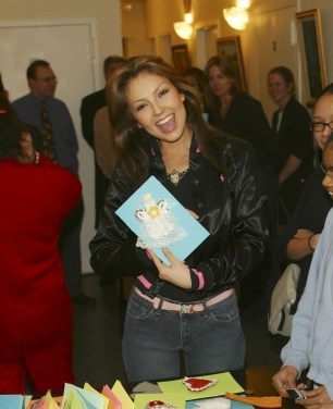 Thalia Joins Broadway Housing Project Children From The Robin Hood Foundation After School Program to Hand Out Holiday Gifts (14)