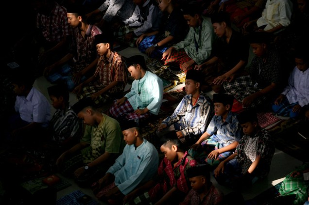 Students perform an afternoon prayer on the first day of Ramadan, at Ar-Raudlatul Hasanah Islamic boarding school in Medan, North Sumatra, Indonesia, on July 10, 2013. (AP Photo/Binsar Bakkara)