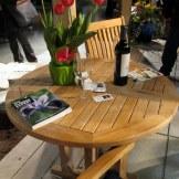 Country Teak table in Graystone Masonry display