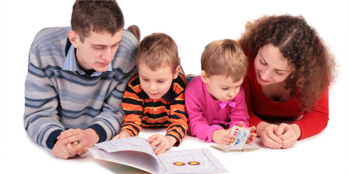 parents look books with children