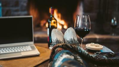 A single person having a virtual vacation by the fireplace