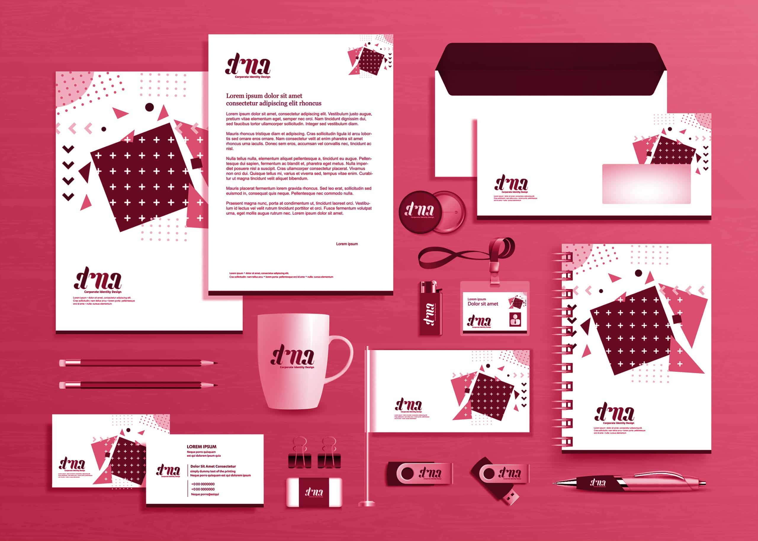 Various brand assets like business cards and letterhead are spread on a surface