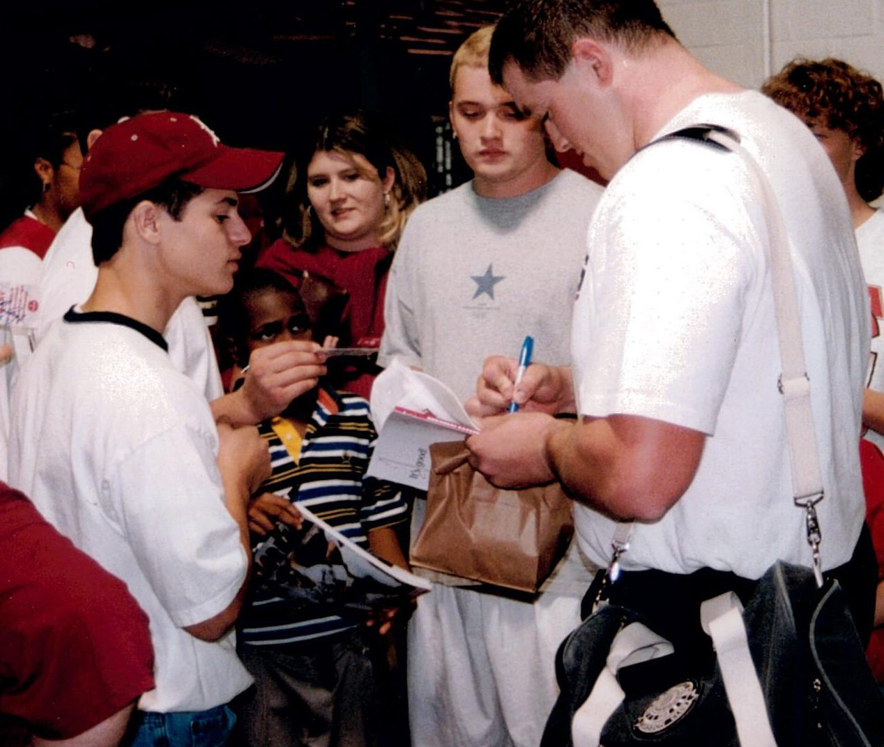 Brandon Burlsworth signs autographs after a game during the 1998 season. (Photo by Marty Burlsworth)