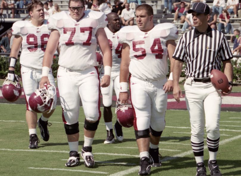 The real Brandon Burlsworth (77) and some of his teammates cross the field at the University of South Carolina. (Photo by Brandon's brother Marty Burlsworth.)